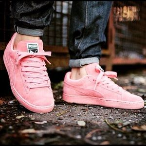 Light pink suede puma sneakers.